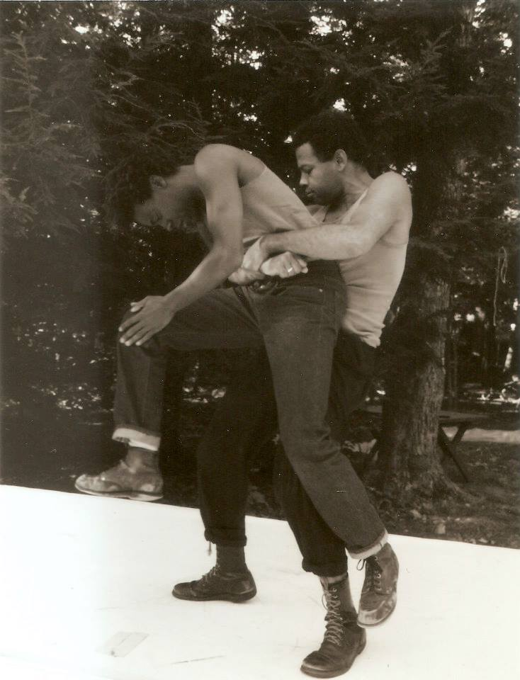 A young Ishmael Houston-Jones lifts a young Fred Holland
